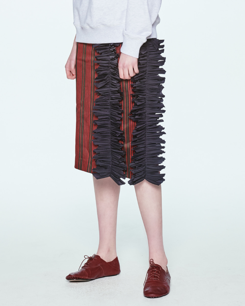 SIDE PLEATS POINT FRILL STRIPE SKIRT
